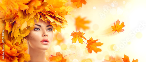 Poster - Autumn woman. Fall. Beauty model girl with autumn bright leaves hairstyle