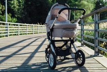Baby Stroller On Running Path In Park