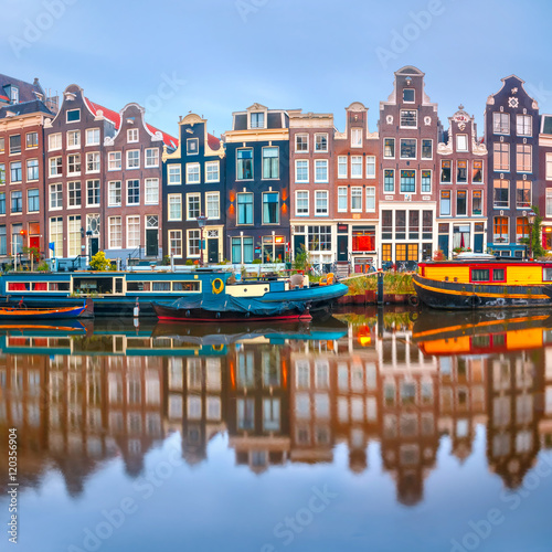 Fotografija Amsterdam canal Singel with typical dutch houses and houseboats during morning blue hour, Holland, Netherlands