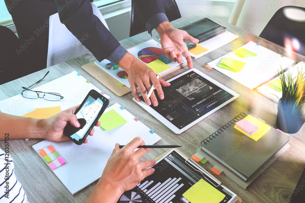 Fototapeta business documents on office table with smart phone and laptop c