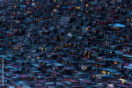 Poster Lama Top view monastery at Larung gar (Buddhist Academy) in sunset time, Sichuan, China