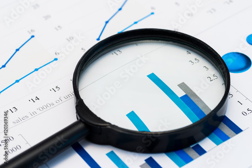 Fotografia  Business Analysis Image - magnifying glass on graphs and spreadsheet