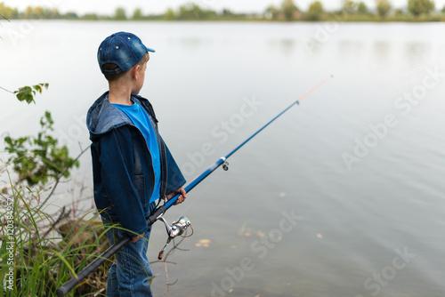 Fotobehang Vissen child on a summer fishing on the shore