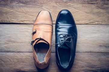 Leather shoes lay on the wooden floor concept for work