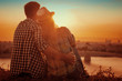 canvas print picture - Young couple enjoying the sunset