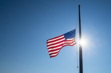 American Flag Flies At Half Ma...