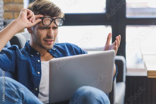 sad freelancer staring into laptop Canvas Print