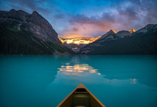 Viewing Snowy Mountain In Rising Sun From A Canoe
