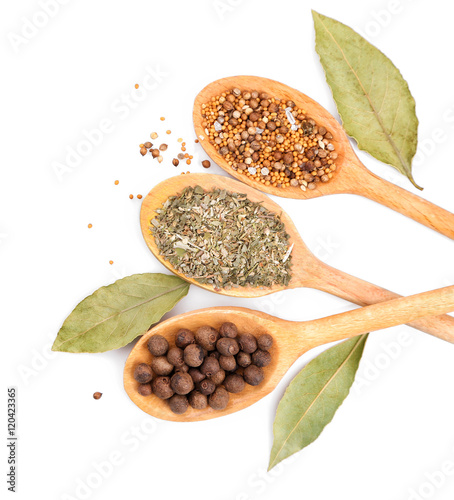 Foto op Canvas Kruiden 2 Different spices in spoons on white background