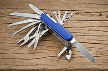 Used Multifunction Pocket Knife On Old Wood