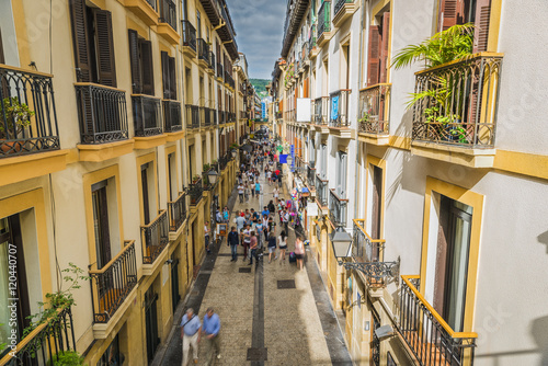 Photo  Narrow Street full of people, San Sebastian Old Town - Spain