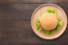 Top View BBQ Burger On Wooden Dish On Wooden Background.