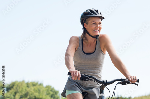 Mature woman cycling Tablou Canvas