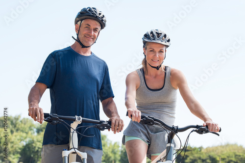Fotografie, Tablou  Senior couple cycling