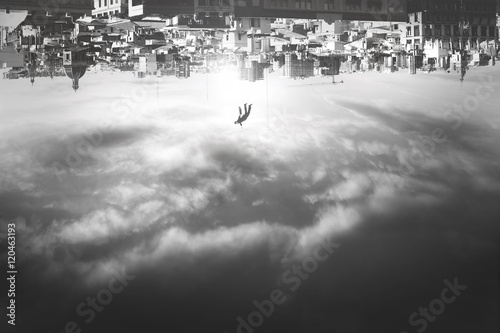 man falling from upside down city Canvas Print