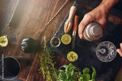 Cuadros en Lienzo Barman preparing cocktail in shaker