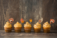 Thanksgiving Cupcakes On Wooden Background