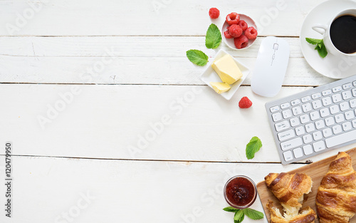 Fototapeta breakfast time with croissants and coffee at workplace obraz