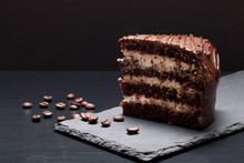 Chocolate Cake On Slate Plate On Black Background. Selective Foc