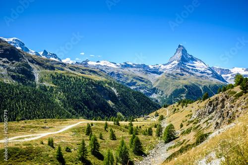 Matterhorn - small village with houses in beautiful landscape of Zermatt, Switze Poster