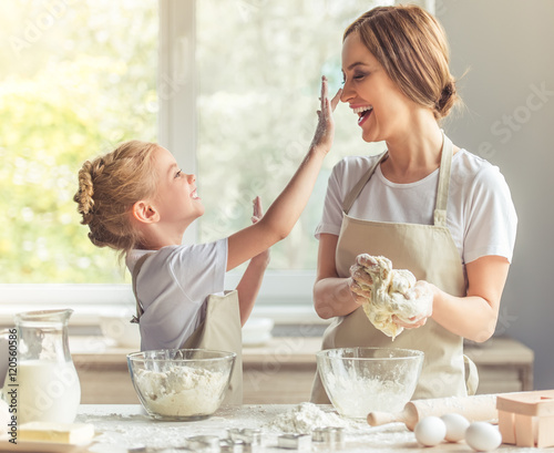 Mother and daughter baking Canvas Print