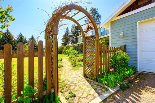 Fotografiet View of Wooden arbor. Arched entry to the garden.