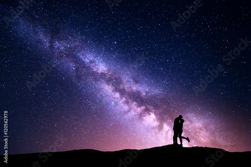 In de dag Groene koraal Milky Way. Night landscape with silhouettes of hugging and kissing man and woman on the mountain. Colorful sky with stars. Silhouette of lovers. Couple, relationship. Milky way with people. Universe
