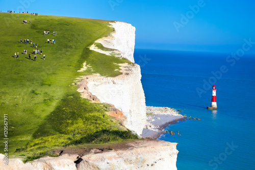 Fotografie, Obraz  Beachy Head Lighthouse with chalk cliffs near the Eastbourne, East Sussex, Engla