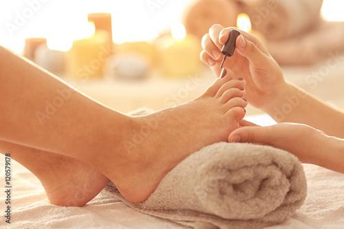 Poster Pedicure Woman having pedicure at salon