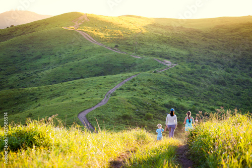 Fotografia, Obraz  Mother and her daughters walking in hills