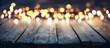 Leinwandbild Motiv Bokeh Of Christmas Lights On Vintage Wooden Plank