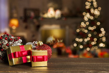 Christmas Background With Christmas Tree On Wooden Table. Red, Golden And Silver Ornaments.