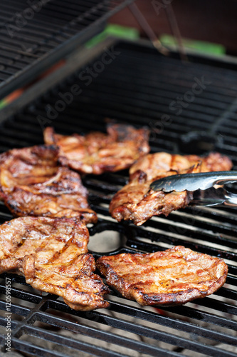 Fotografia, Obraz  Grilled pork almost ready on the grill