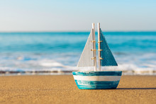 Toy Sailboat At The Seashore
