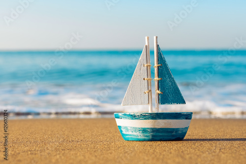 toy sailboat at the seashore Wallpaper Mural