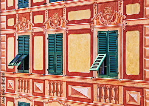 Poster Liguria Liguria, Italy - painted house trompe-l'oeil detail of windows