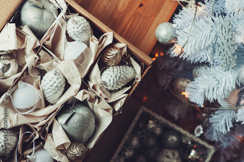 Foto op Canvas Kerstmis white and silver Christmas decorations in box, celebrating New Year 2017 at home