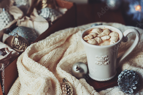 Foto op Canvas Kerstmis cup of hot cocoa with marshmallow with Christmas decorations at home, Christmas tree on background, cozy mood