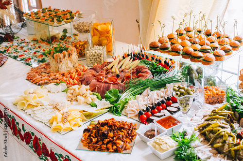 Papiers peints Buffet, Bar Buffet table of reception with burgers, cold snacks, meat and salads