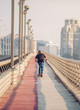 Skateboarder skates over a city bridge. Free ride street skateboarding