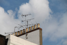 A Classic Rooftop Collection Of Chimneys And Aerials.