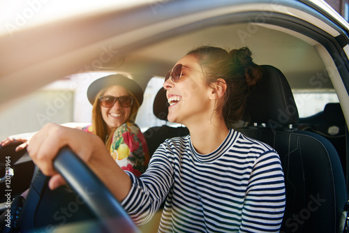 Fotografie, Obraz  Smiling happy woman giving her friend a lift