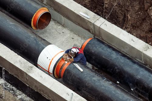 Vászonkép Welding a pipes on a mainheating construction site