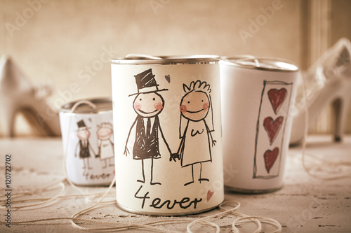 Fotografie, Obraz  Married forever symbol written on stringed cans