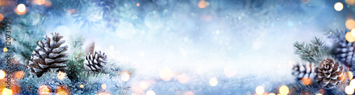 Fotografía  Christmas Decoration Banner - Snowy Pine Cones On Fir Branch With Lights