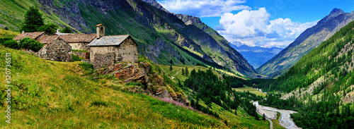 The old architecture with mountains on the panoramic view in Aosta Wallpaper Mural