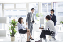 Four Businessmen, Have Been Meeting In A Bright Office
