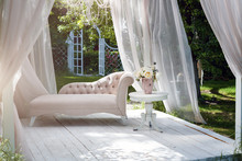 Summer Garden Gazebo With Curtains And Sofa For Relaxation.