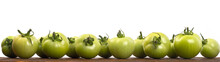 Green Tomatoes On A Wooden Shelf With A White Background