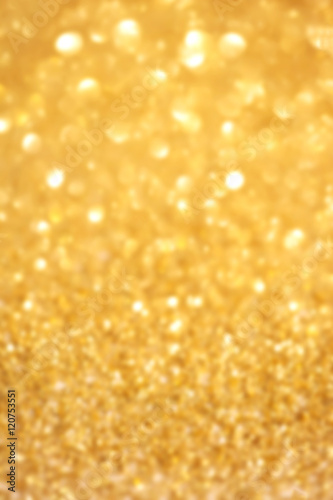 ..Golden glitter Christmas abstract background with defocused sp